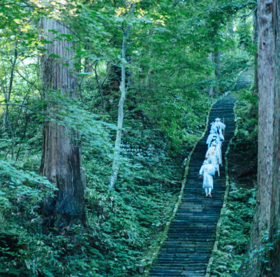 Yamabushi train on the stone stairway of Mt. Haguro of the Dewa Sanzan
